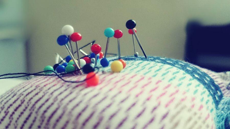 Close-Up Of Straight Pins On Pin Cushion