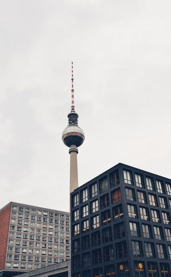 Low angle view of buildings and fernsehturm against sky