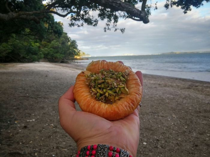 Good Morning 😃would you like something sweet?😍 Baklava Pistachio Pastry Syrup Ready-to-eat Turkish Food Gourmet Sweet Food Dessert Meal Hand Outdoors Colour Image Indulgence Otitori Bay French Bay Titirangi New Zealand Beach Photography Preparation  Surf's Up Food and Drink Horizon Over Water Circular Showcase: February