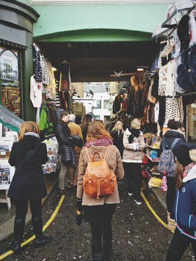 Rear view of people on street market