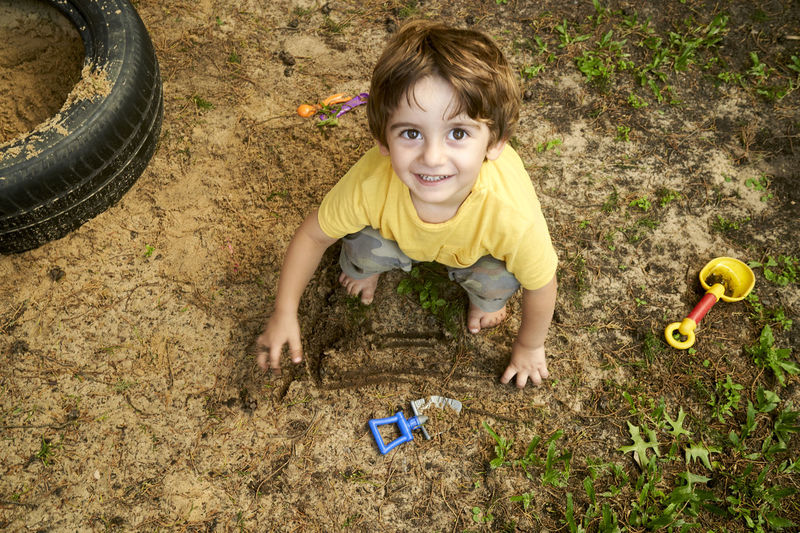 High angle view of boy playing on farm