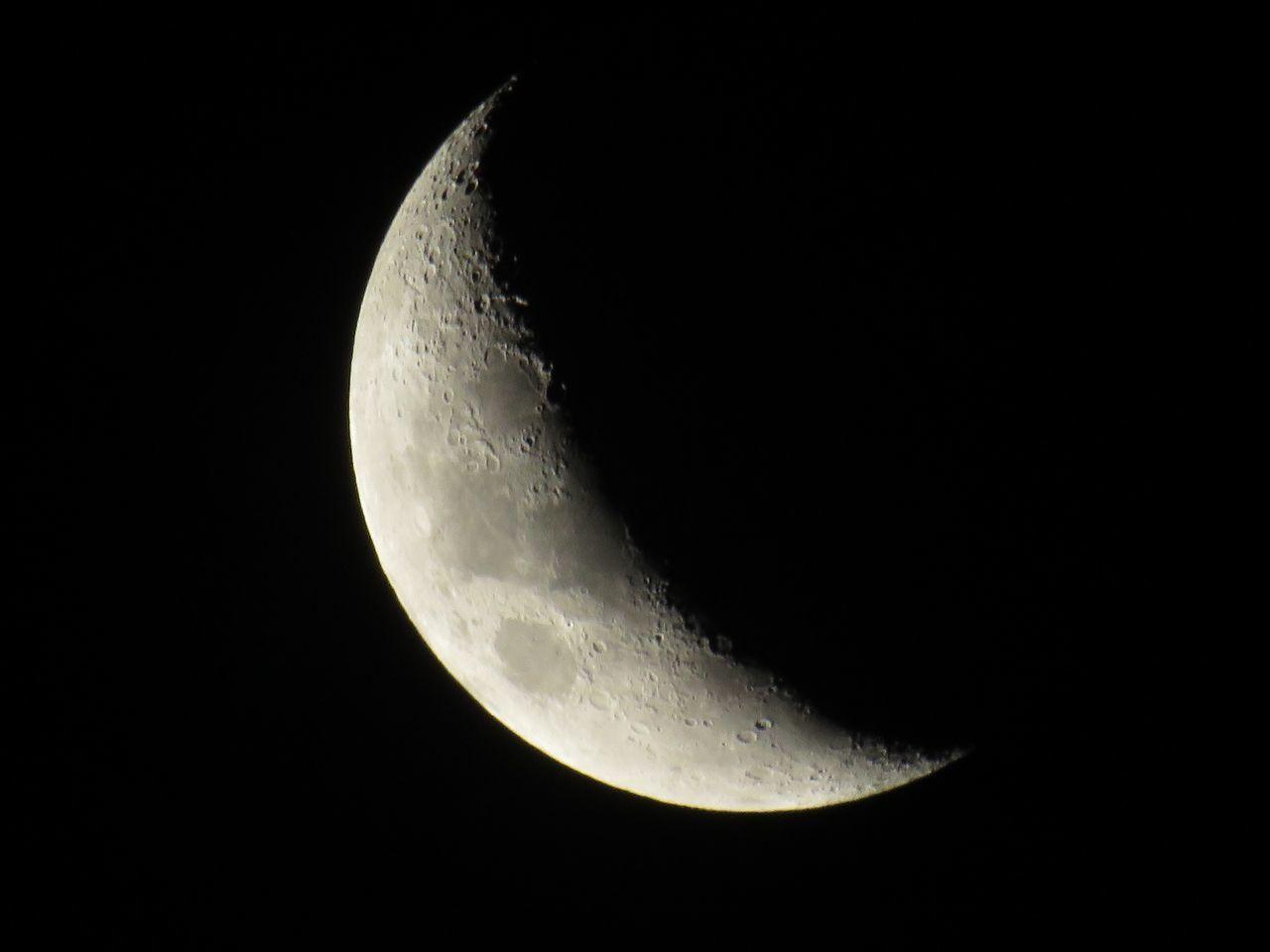 LOW ANGLE VIEW OF HALF MOON AT NIGHT