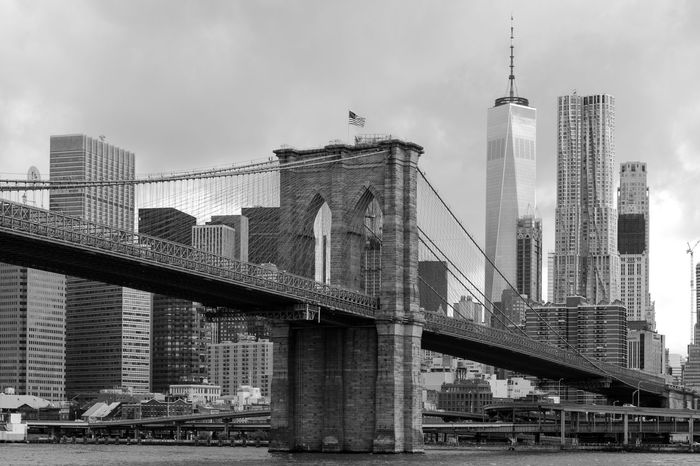 Brooklyn Bridge / New York East River Tourist Attraction  Architecture Black And White Bridge Building Built Structure City Cityscape Connection Connections Financial District  Manhatten Modern River Skyscraper Tower Transportation Travel Destinations World Trade Center One
