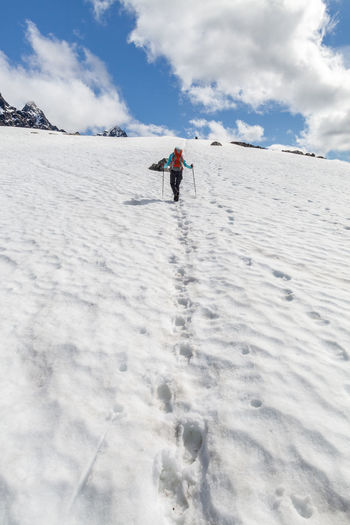 Adventure Beauty In Nature Cloud Cloud - Sky Cold Temperature Covering Day Hiking Landscape Leisure Activity Lyngsalpan Mountain Nature Northern Norway Norway Outdoors Scenics Season  Sky Snow Unrecognizable Person Vacations Warm Clothing Weather Adventure Club