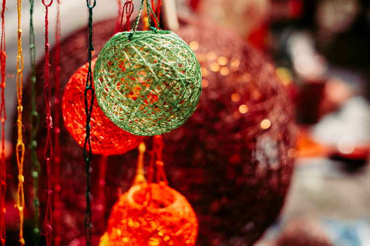 handmade light lantern encasing made from the organic Philippines plant Abaca Abaca Copy Space Lantern Light Philippines Art And Craft Backgrounds Celebration Christmas Christmas Decoration Christmas Ornament Close-up Colorful Craft Day Decoration Design Focus On Foreground Handmade Hanging Holiday Object Red Sphere Thread Autumn Mood Holiday Moments A New Perspective On Life Capture Tomorrow My Best Photo Humanity Meets Technology Streetwise Photography The Art Of Street Photography