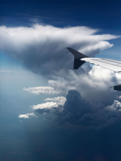 Cloud - Sky Sky Flying Airplane Air Vehicle Mode Of Transportation Aircraft Wing Transportation Nature No People Mid-air Day Travel Cloudscape Beauty In Nature Sunlight on the move Scenics - Nature Outdoors Blue Above White Cloud And Sky