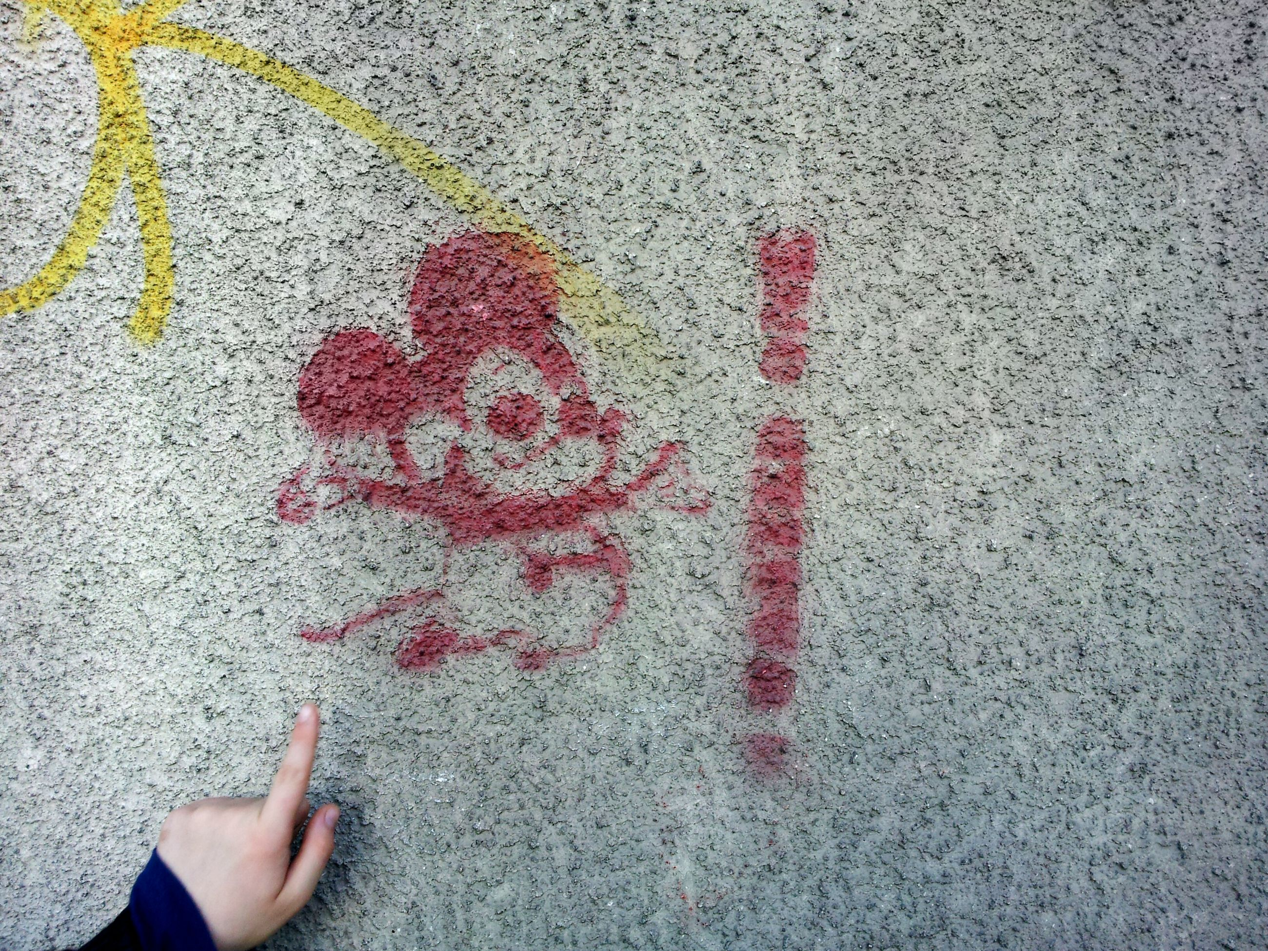 communication, high angle view, street, text, person, part of, western script, textured, unrecognizable person, lifestyles, asphalt, road, heart shape, close-up, road marking, creativity, day