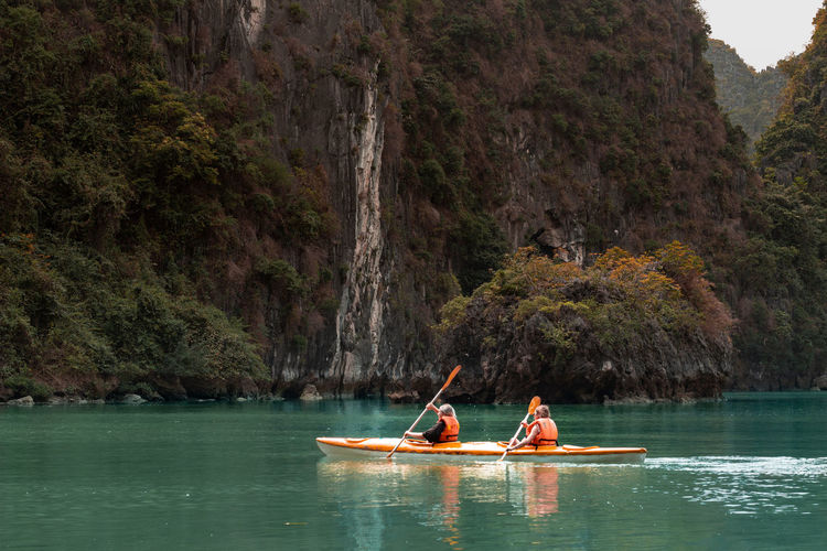 People canoeing on river