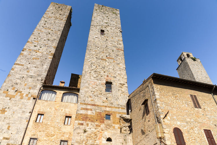 The towers in San Giminano, Italy San Gimignano Tuscany Architecture Blue Building Building Exterior Built Structure City Clear Sky Day History Italy Low Angle View Nature No People Old Outdoors Sky Sunlight The Past Tower Travel Destinations Window