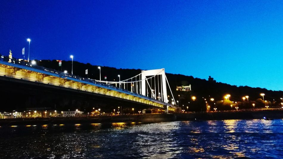 Budapest, Hungary Erzsebet Bridge Bridge - Man Made Structure Night Connection Architecture Illuminated Built Structure River Outdoors Transportation Suspension Bridge No People Sky City Clear Sky Water Cityscape