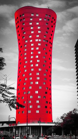 Low angle view of red built structure against sky