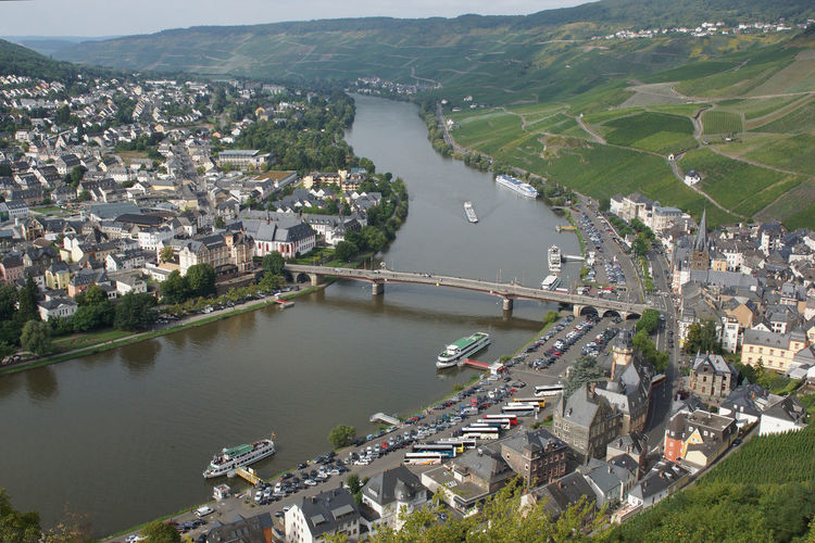 High angle view of river and town in city