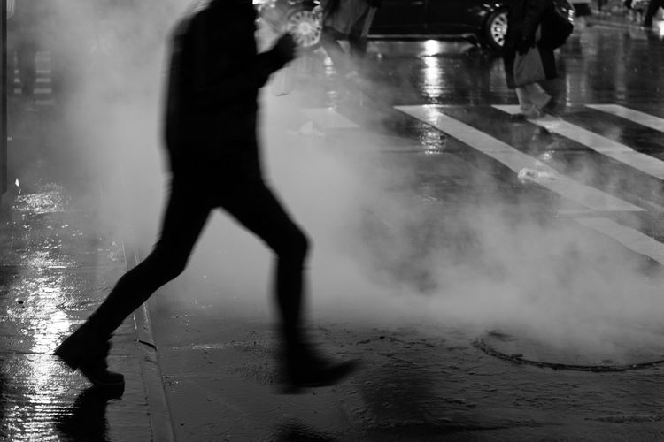 Man in Motion. Streetphoto_bw Nycphotography Blackandwhitephotography Man Motionblur Steam Rainynight Nightphotography Sony A6000 Project365