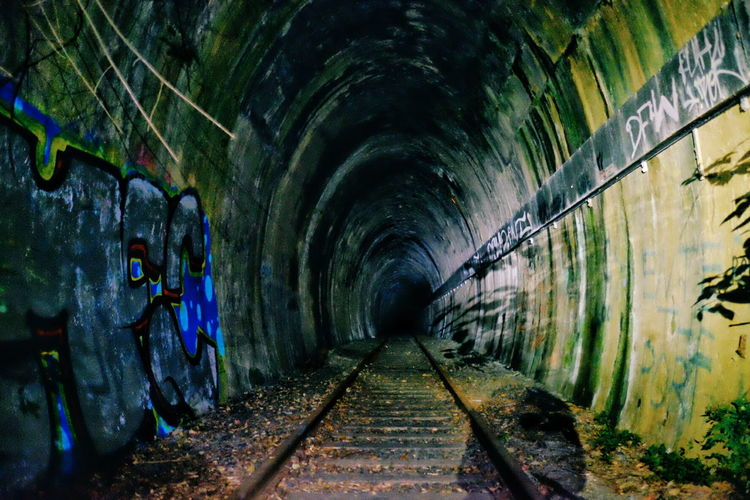 Abandoned Arch Architecture Archway Bad Condition Built Structure Damaged Day Deterioration Diminishing Perspective Dirty Graffiti Indoors  Light At The End Of The Tunnel Long Messy Narrow Obsolete Old Railroad Track Surface Level The Way Forward Tunnel Vanishing Point Weathered