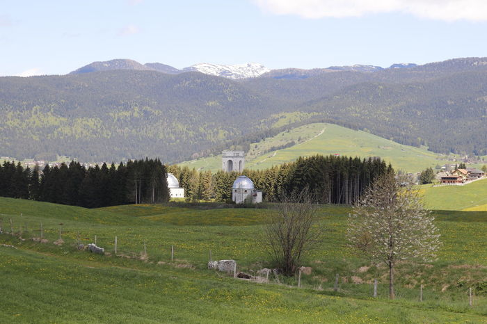 panoramic view of the astronomical observatory and the war memorial of the First World War Astronomical Observatory Astronomical Observations Architecture Beauty In Nature Built Structure Day Environment Field First Mondial War Grass Green Color Land Landscape Memorial Site Mountain Mountain Range Nature No People Outdoors Plant Scenics - Nature Sky Tranquil Scene Tranquility Tree