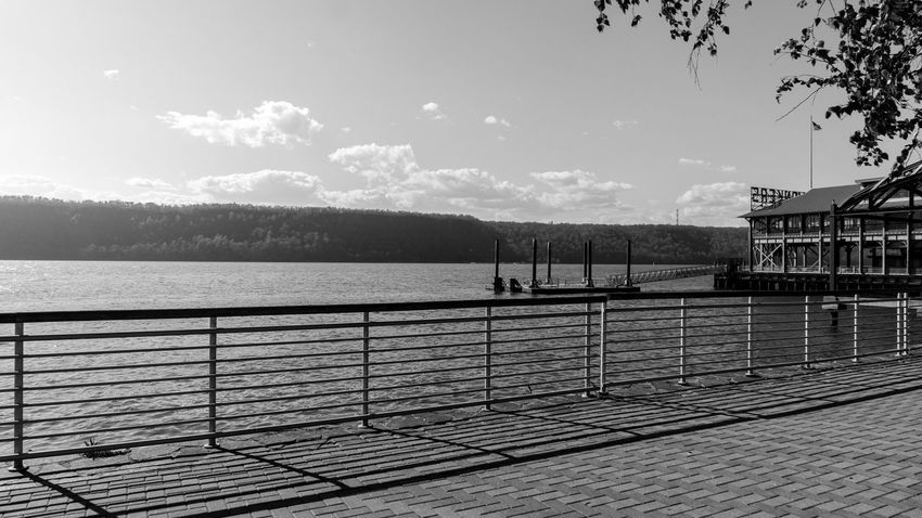 Riverfront. Black And White Photography Landscape Light And Shadow Clouds And Sky River Trees Dock Project365 Sony A6000