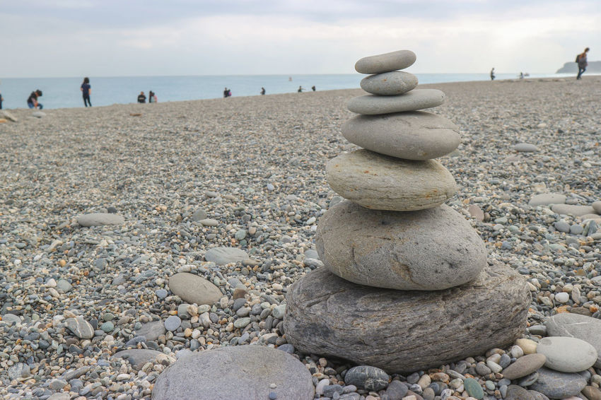 a zen stone stack at the beach Claim Travel Balance Beach Day Focus Horizon Over Water Incidental People Land Nature Outdoors Pebble Rock Rock - Object Scenics - Nature Sea Sky Solid Stack Stone Stone - Object Tranquil Scene Tranquility Water Zen-like