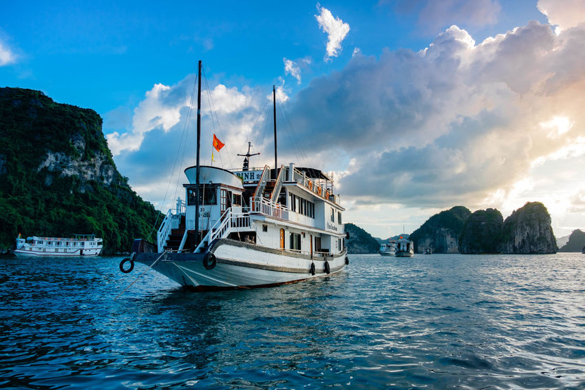 A small cruise ship laying at anchor in Ha Long Bay. Beauty In Nature Cloud - Sky Day Harbor Luxury Mast Mode Of Transport Moored Nature Nautical Vessel No People Outdoors Sailboat Sailing Sailing Ship Scenics Sea Sky Sunset Tranquil Scene Tranquility Transportation Water Yacht