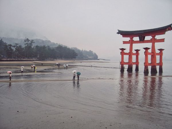 Beach Outdoors Nature People Sky Day Water Tranquil Scene Tranquility Scenics Nature Cold Temperature Rain Landscape Tree Hills Fog Hiroshima Japan Miyajima Tori Travel Travel Destinations Ladyphotographerofthemonth
