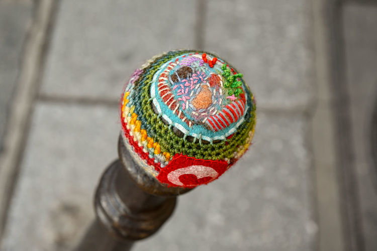Yarn bombing in a street of the Marais district, Paris Multi Colored Close-up No People Focus On Foreground Outdoors Pattern Single Object High Angle View Shape Design City Selective Focus Art And Craft Red Ornate Yarn Bombing Knitting Urban Knitting Graffiti Knitting Paris Le Marais Street Art