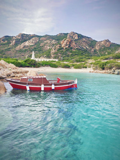 Water Nautical Vessel Transportation Mountain Mode Of Transportation Sky Day Sea Beauty In Nature No People Nature Tranquility Turquoise Colored Travel Tranquil Scene Outdoors Boat Mediterranean  Ocean Purity Serenity Travel Summer Sardinia Beachphotography
