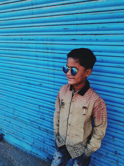 stylish boy Kid's Style Sunglasses Portrait Shutter Looking At Camera Corrugated Iron Young Adult Standing