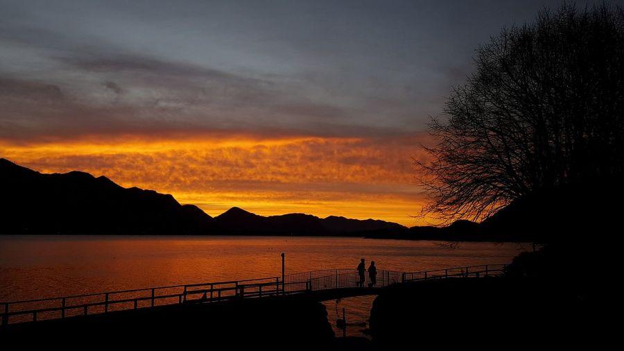 Lake Reflection Cloud - Sky Dramatic Sky Mountain Scenics Silhouette Beauty In Nature No People Tree Water Lucariva Sunrise Tranquil Scene Alba Cielo S6