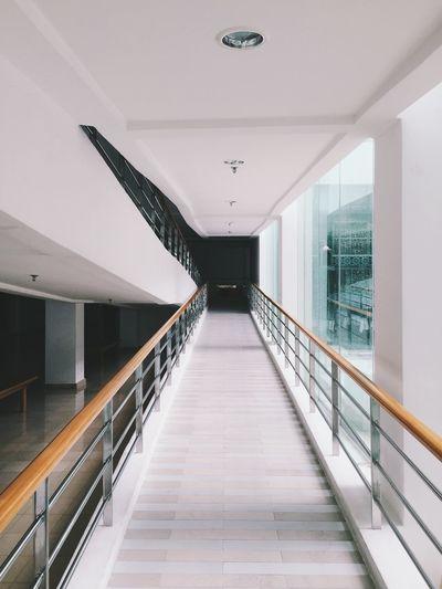 Long empty corridor along walls