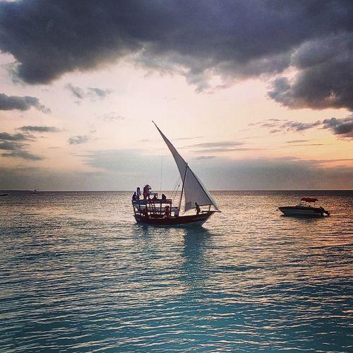 Relaxing Nungwibeach Nungwi Zanzibar🏊🏄🎣 Zanzibar_Tanzania Zanzibarisland Coco Cabana Nungwi Beach Marty Indean Ocean Boat Sunset_collection Sunset