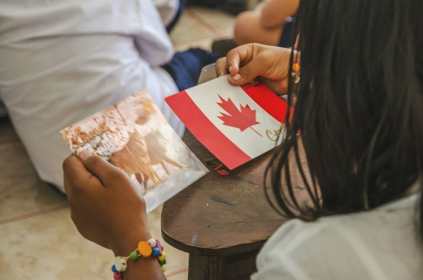 Flag Close-up Canada Canadian Flag Sharing Culture Multicultural Teaching Learning Young Girl Culture Cultures School Girl Brown Skin Dark Hair Midsection Patriotism Antipatriotism New Ideas New Identity Canadian Sharing  Democracy People