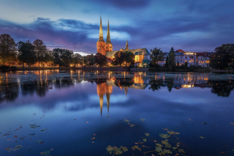 Lübecker Dom am Mühlenteich Blue Hour Cathedral EyEmNewHere EyeEm Best Shots Historical Building Lübecker Dom Pont Architecture Beauty In Nature Building Building Exterior Built Structure Church Architecture City Cloud - Sky Dusk Historical Center Lake No People Outdoors Plant Reflection Sky Tree Water