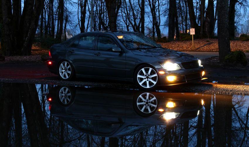 told everyone that one day I'd have a Lexus Wet Lexusis300 Lexus Is300 2jz Clean Culture Lowered Loweredlifestyle Brap Moretocome Reflection AchievedTheGoal Car Time Destruction Vehicle Light Headlight