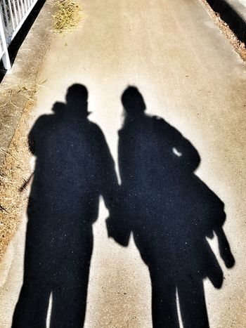 Two People Shadow Focus On Shadow Real People Sunlight Lifestyles Togetherness Day Outdoors IPhone7Plus IPhoneography Valentine's Day  Love Iphonephotography Couple Holding Hands The City Light