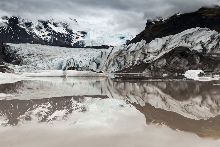 Beauty In Nature Cold Temperature Frozen Glacier Ice Iceberg Icleand Lake Melting Mountain Nature No People Reflection Scenics Snow Snowcapped Mountain Tourist Attraction  Tranquil Scene Tranquility Water Winter