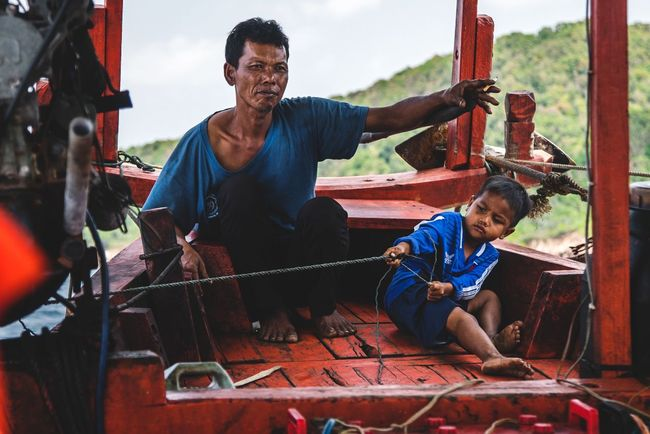 A helping hand has no age Only Men Mature Adult Two People Real People Teamwork Cambodia Showcase: April Travel Sea Fisherman Work Working Working Hard ASIA Travel Photography The Photojournalist - 2017 EyeEm Awards Be. Ready.