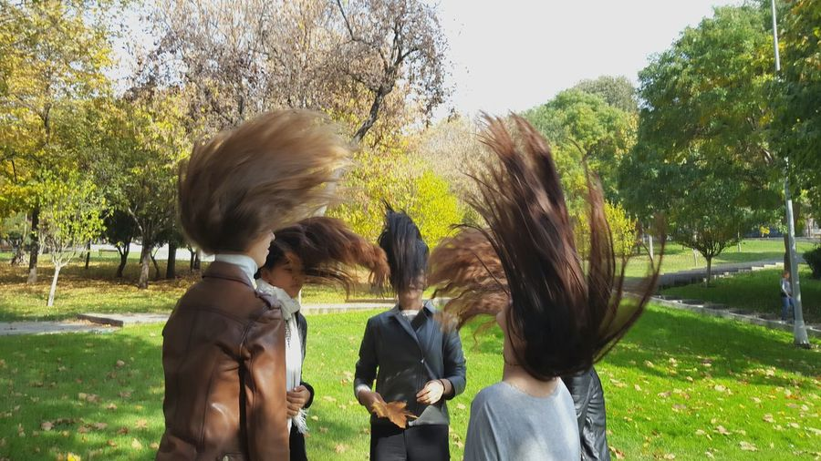 Hair is in the air Togetherness GirlsJustWannaHaveFun Hair In The Wind Hair Up Playing With Hair in the park Teamwork Autumn Colours Street Photography Happy Girls Funny Hair Style Hairstyle Hairy  Flying Hair People Photography People In The Park Autumn Colors Autumn In The Park  Parkgirls Girls