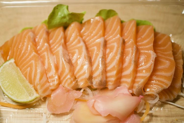 Animal Citrus Fruit Close-up Fish Food Food And Drink Freshness Fruit Healthy Eating Indoors  Japanese Food Meat No People Raw Food Ready-to-eat Salmon Salmon - Seafood Salmon Sashimi Sashimi  Seafood SLICE Still Life Tray Wellbeing