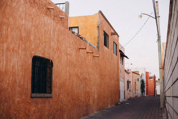 Empty street with colourful houses in tequisquiapan, mexico