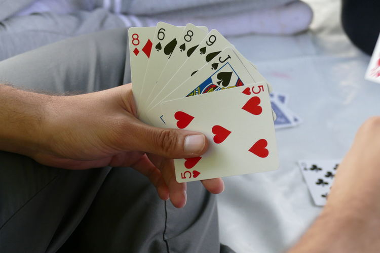 Beating  Freinds Hands Playing With Cards Poker Winter Backgrounds Beat Card Card Numbers Competition Compititive Conkan Exiting Game Leisure Activity Loss Outdoors People Playing Turks Winner