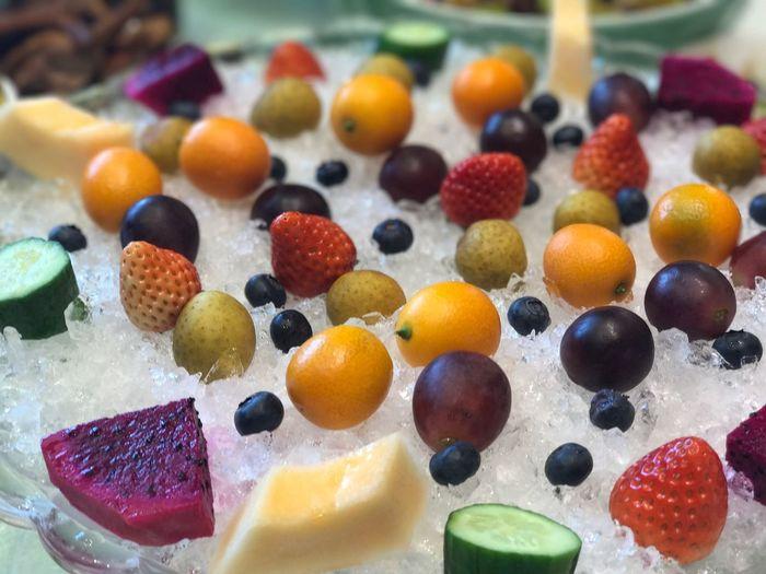 High angle view of colorful fruits on crushed ice