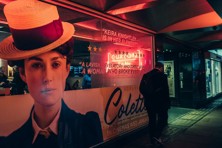 Portrait of man standing in illuminated restaurant