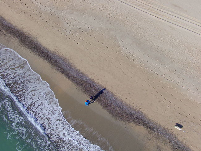 Couple Walking The Dogs On The Beach Drone  Beauty In Nature Day Drone Photography High Angle View Men Nature Outdoors People Real People Sand Scenics Water