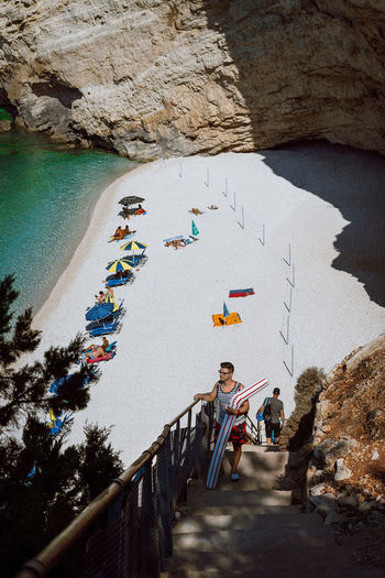 Greece Vacation Destination Vacations Rocks Stairs People Summer Water Beach Sand Shadow Sunlight Shore Coast Pebble Beach Rock Formation Geology Natural Arch Eroded Seaside Sea The Art Of Street Photography