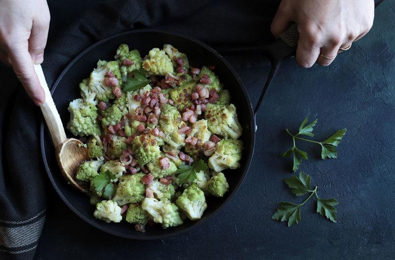 Stir-fried romanesco cauliflower with ham and parmesan.