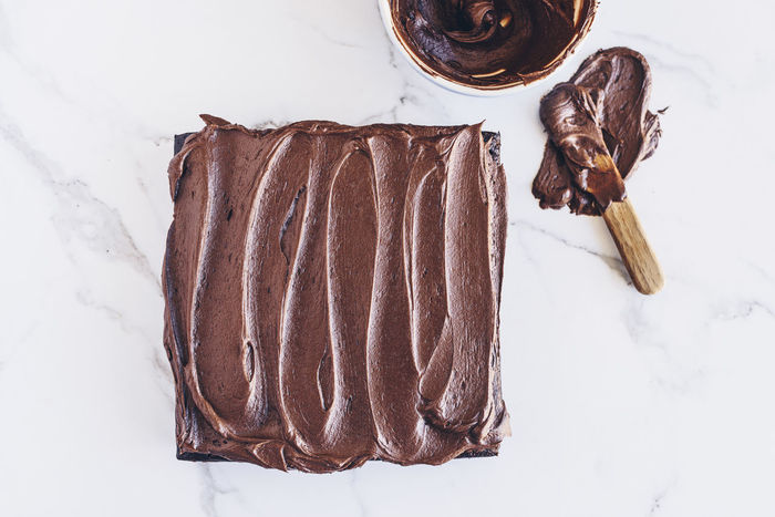Frosting Icing Square Bowl Brown Cake Chocolate Close-up Dark Chocolate Day Directly Above Food Food And Drink Freshness High Angle View Indoors  Landscape Marble No People Ready-to-eat Spatula Surface Sweet Food Wooden