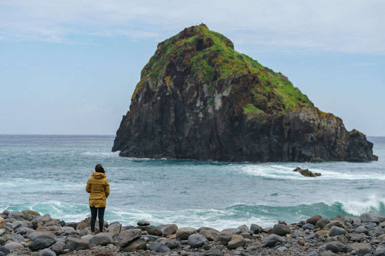 Woman looking at Ribeira da Janela islet in Madeira Madeira Portugal Island Ilha Landscape Nature Islet Ribeira Da Janela Seascape Panorama Panoramic Rock Outdoors Sea Ocean Atlantic Woman Portrait Travel Traveler Portuguese Best  Alone Porto Moniz Ilheu