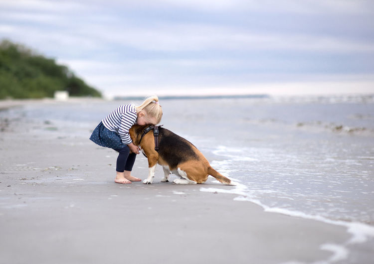 Little girl and her beagle dog on the beach Family Love Animal Themes Beach Beach Day Best Friends Child Child And Dog Day Dog Domestic Animals Full Length Girl Kid Litlle Mammal Nature No People One Animal Outdoors Pets Sand Sea Sky Water Be. Ready.