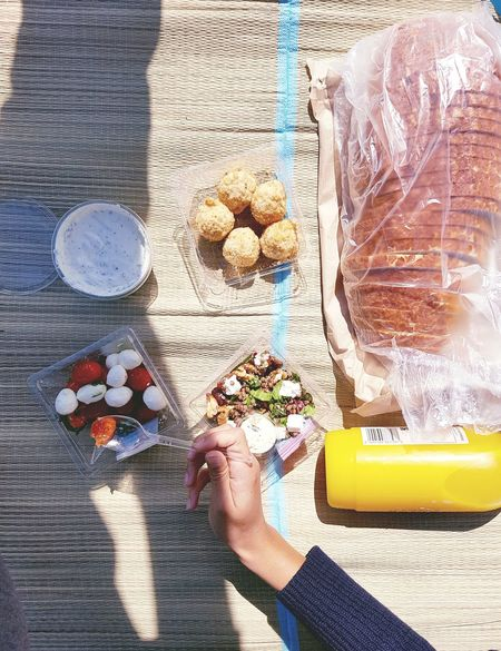 Food And Drink Picnic Food Orange Juice  Tiger Bread Bread Feta Cheese Feta High Angle View Birds Eye View Hand Mozzarella Tomatoes Aubergine Beetroot Tzatziki Yoghurt Lentils