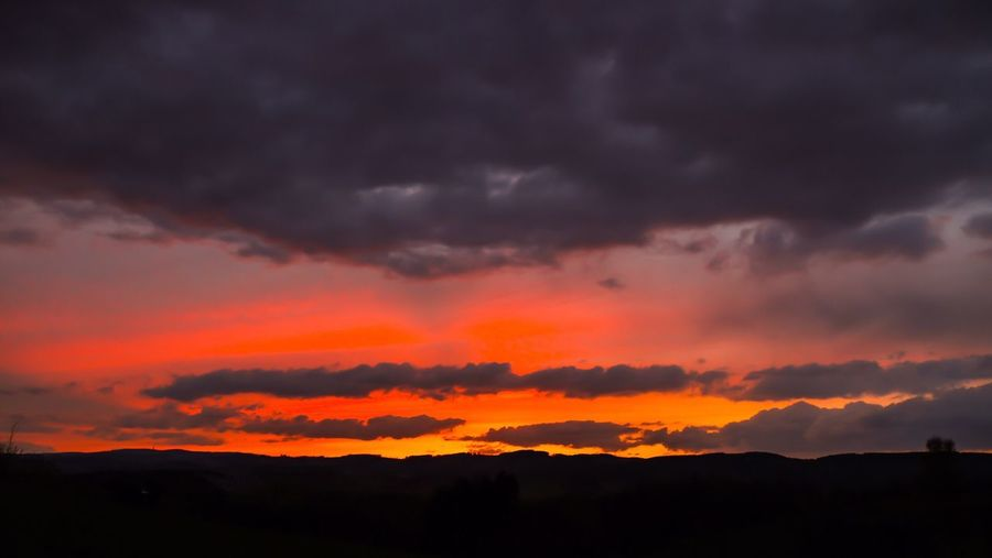 Sunset Beauty In Nature Sky Nature Dramatic Sky Silhouette Cloud - Sky Orange Color Scenics Tranquil Scene Tranquility No People Outdoors Landscape Storm Cloud Day