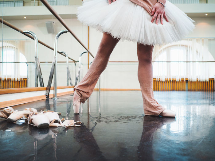 Low Section Of Ballerina Dancing On Floor